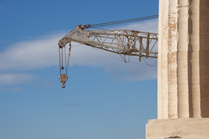 Crane appearing from behind marble Parthenon column