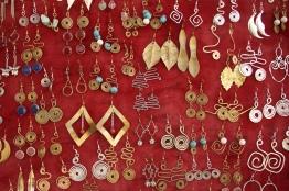 Gold and silver earrings on red velvet
